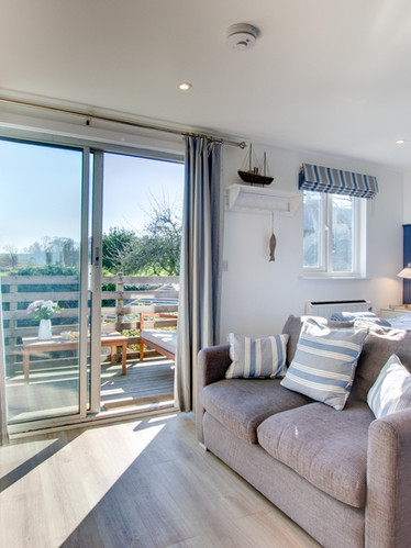 The Signal Box - bed with TV and view of