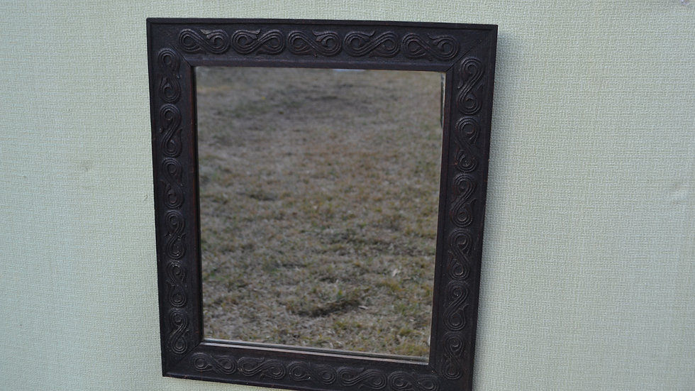 Mirror, with ebonized oak frame carved with Celtic style designs
