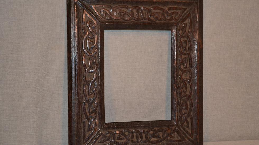 Small frame, ebonized oak with carved Celtic design.