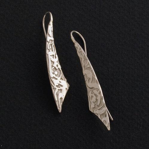 Orecchini pendenti in argento. Gioielli particolari shop online.