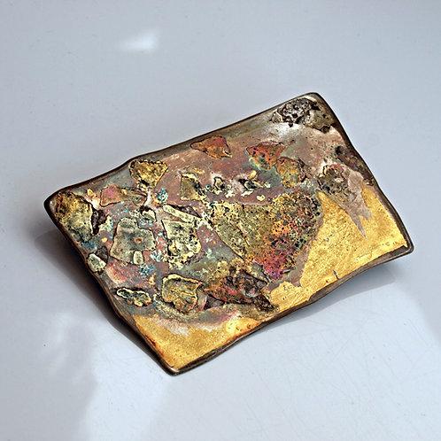 Spilla in oro puro e argento Mokume Gane. vendita online