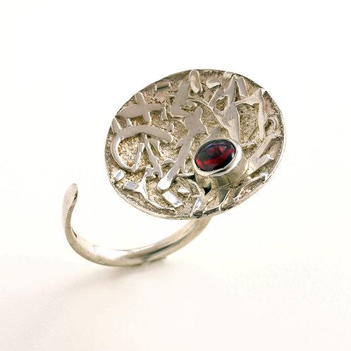 Anello disco in argento con granato