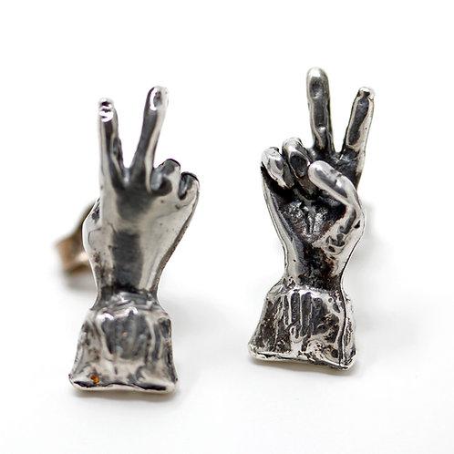 Orecchino in argento. Gioielli artigianali particolari Shop online
