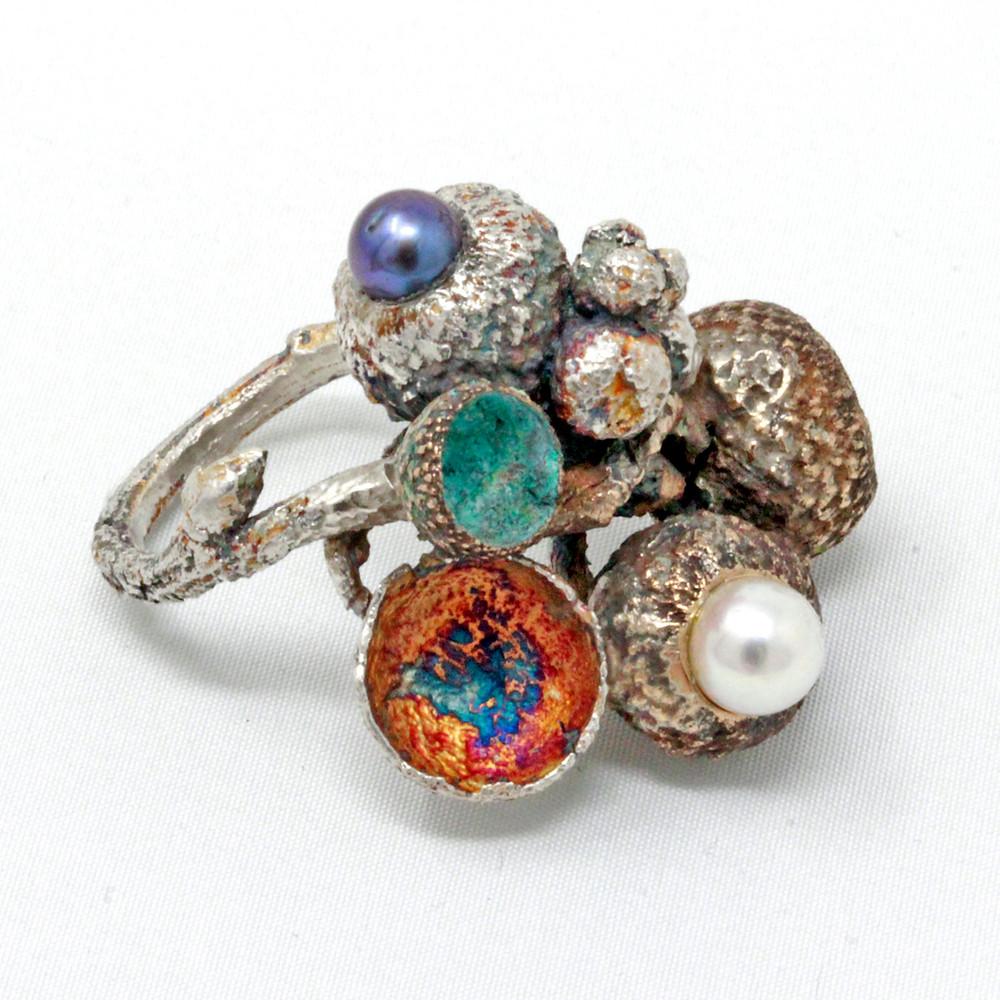 Gioielli artigianali. Anello in argento e bronzo perle coltivate
