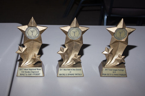 Trophies for Most Improved Team, Most Hole in Ones, and Low League Average