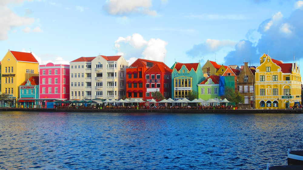 Row of multi-colored buildings on the water