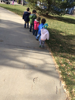 children joining hands