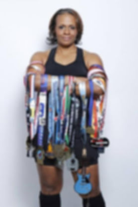 Tekemia Dorsey Holding Awards.jpg
