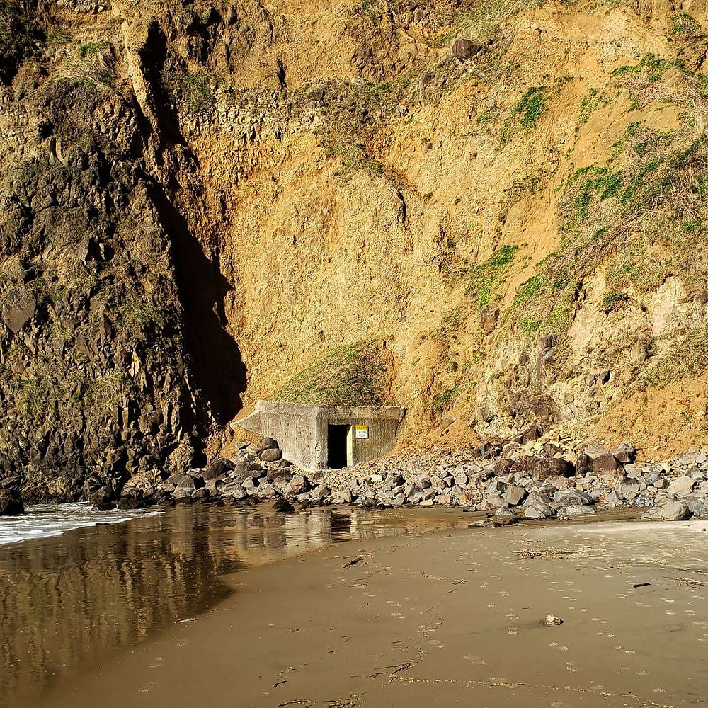 A picture of a tunnel cut into the side of a bluff