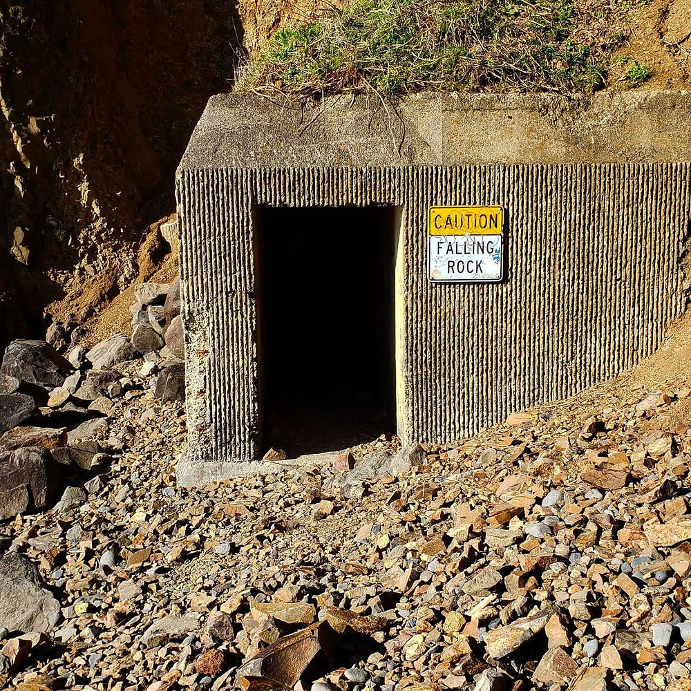 "The tunnel sign that says ""Caution: falling rock"""