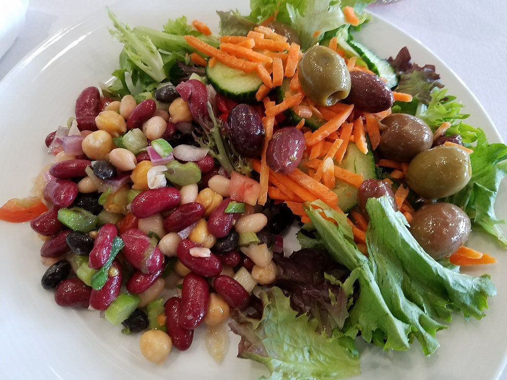 A salad with bean mix, chick peas and olives