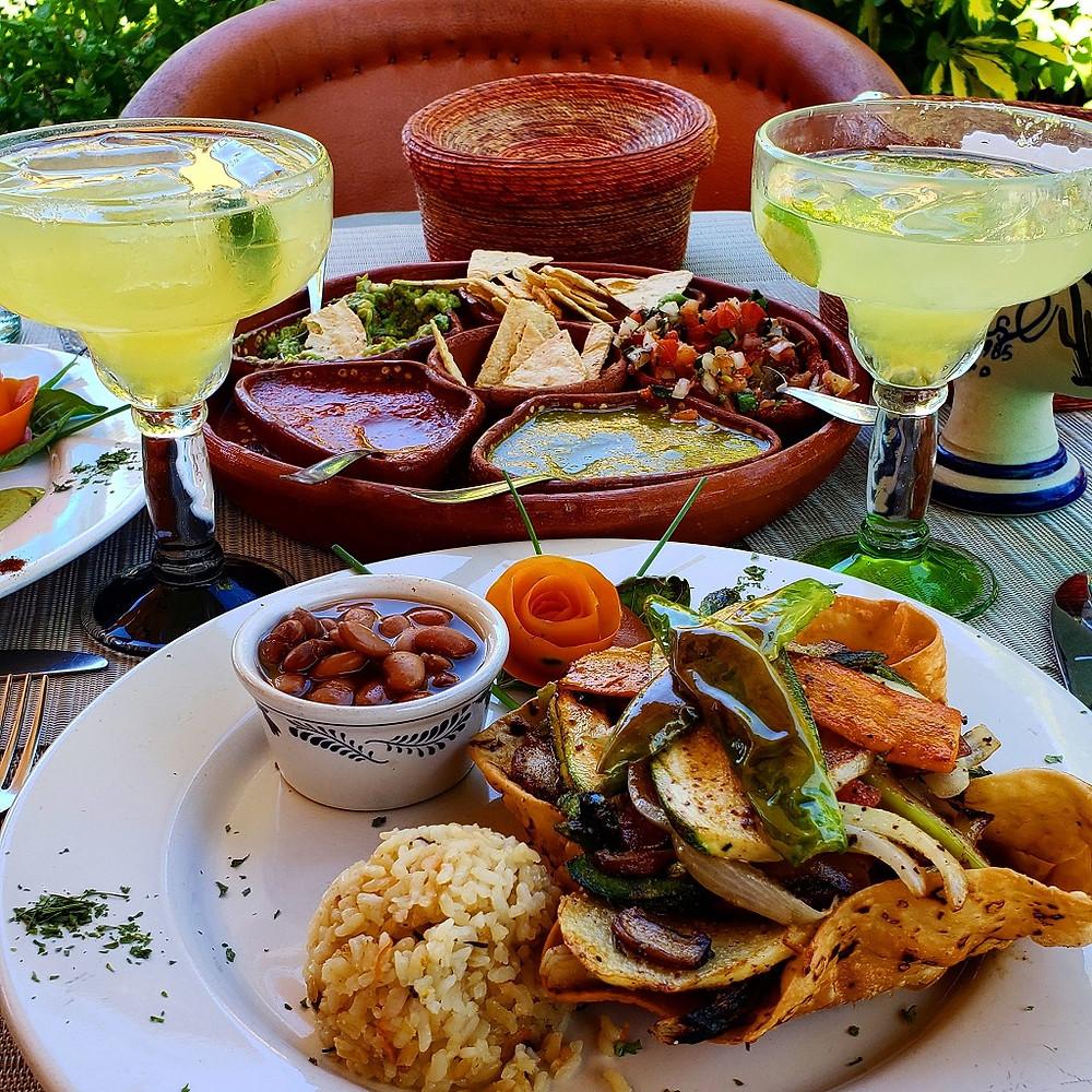 Picture of margaritas and fajita ingredients