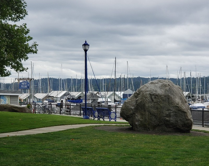A rock in front of a marina