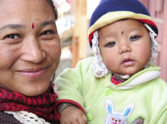 Associate Craft Producer and child, Nepal.