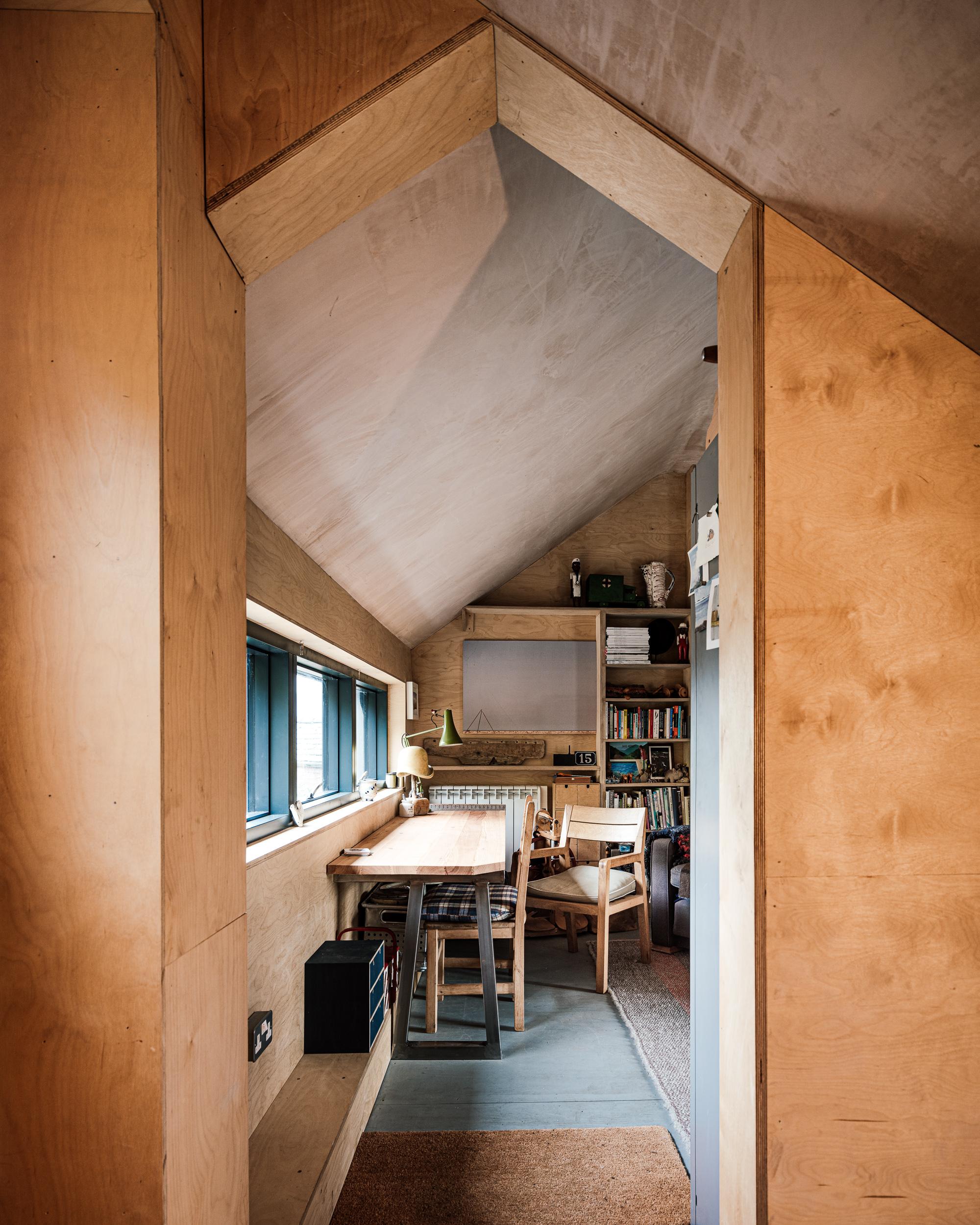 View into Studio, plywood, bare plaster, panoramic window