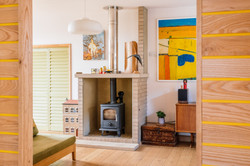 Living room with buff brick fireplace