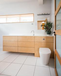 Main bathroom vanity unit in plywood and corian