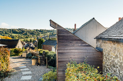 View of Wirksworth, with textures of timber cladding and Fibre cement cladding