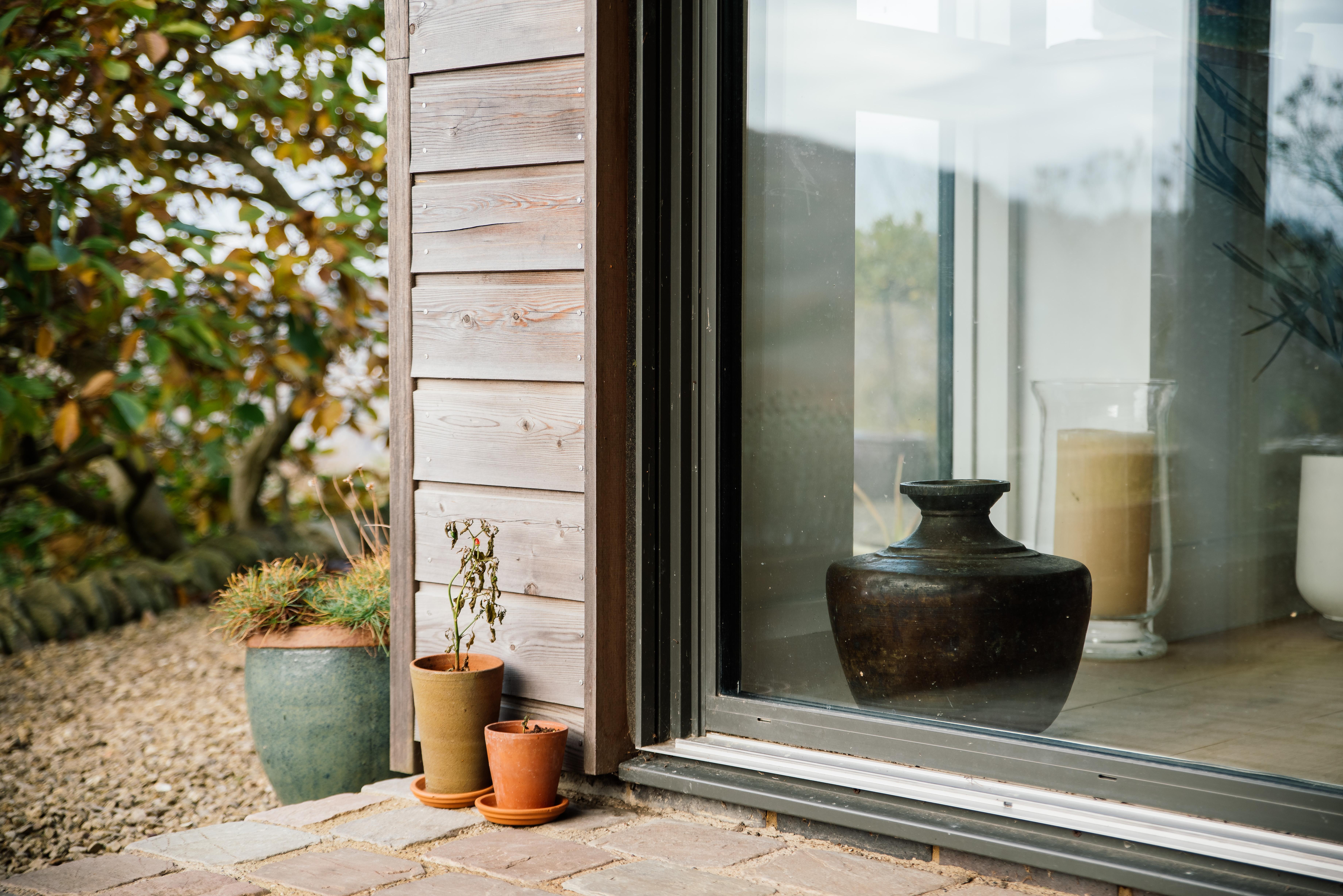 door detail, timber cladding and ideal combi