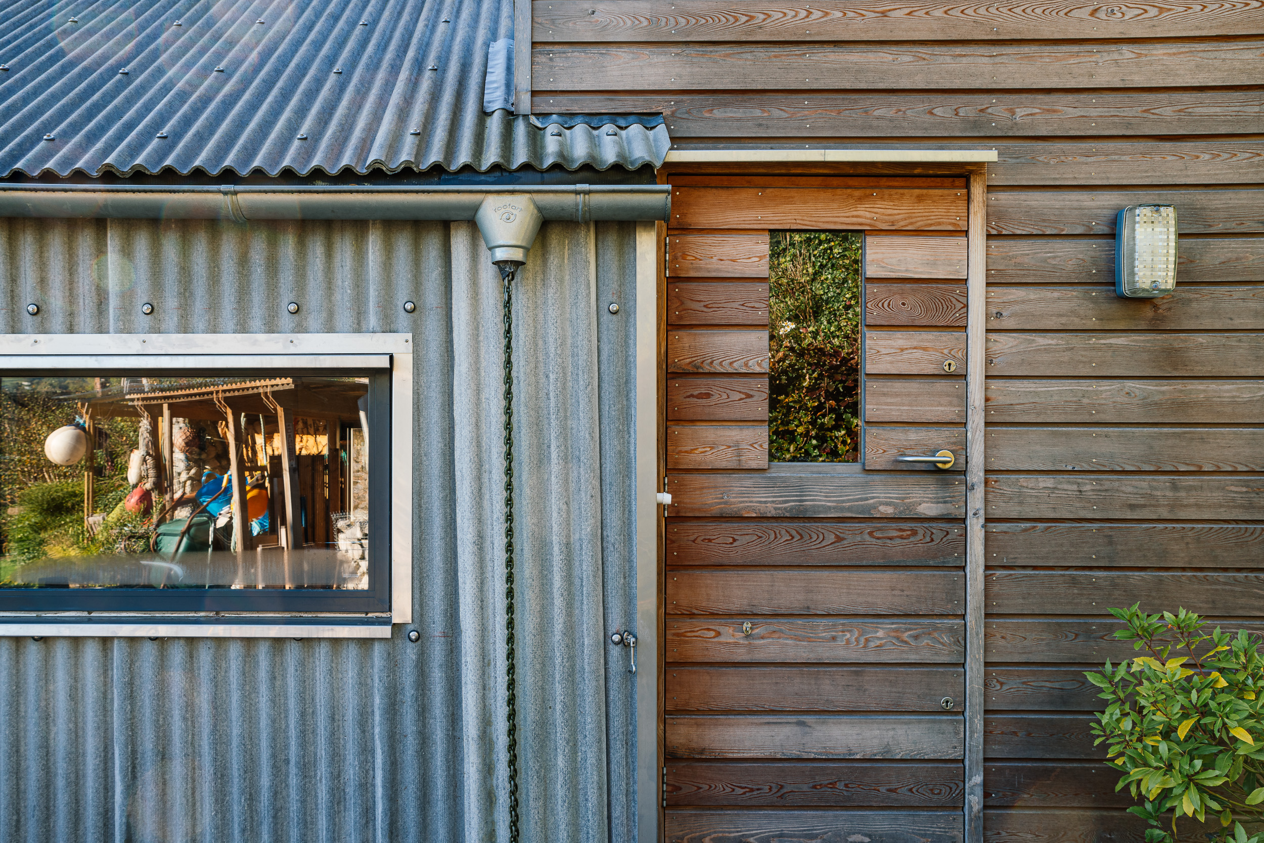 Garden door corrugated fibre cement wall and roof detail, rain chain