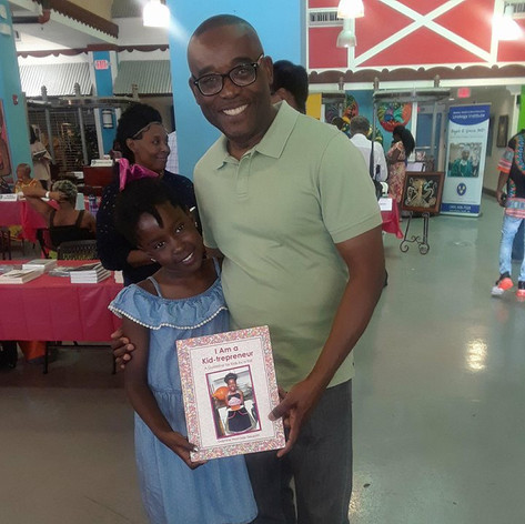 Author Delphine with Commissioner of District 2 Miami Jean Monestime
