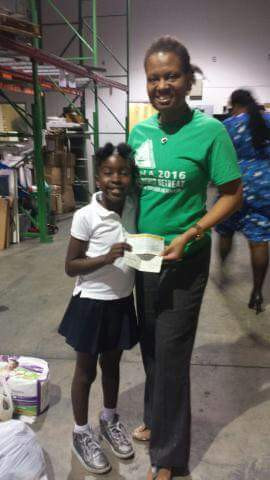 Author Delphine with President of Haitian-American Nurses Association