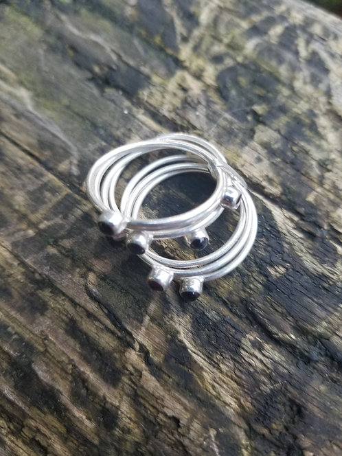 Sterling and Garnet Seven Band Ring