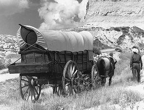 1024px-Conestoga_wagon_on_Oregon_Trail_-