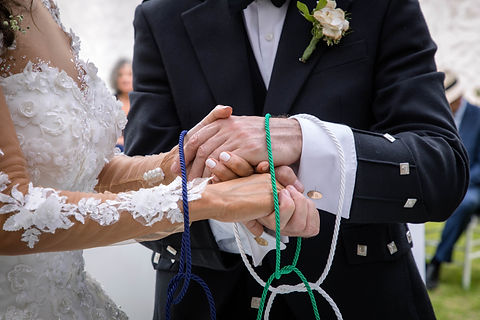 Wedding ceremony hands tied in nautical