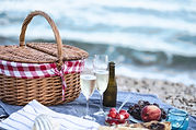 Summer beach  romantic picnic at sunset.