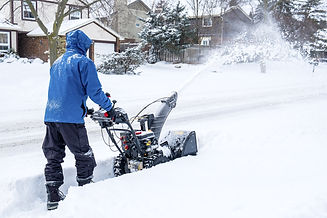 Man Removing Snow with a Snow Blower.jpg