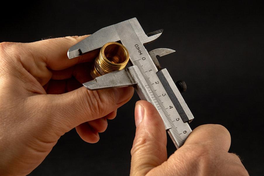 wizard-measures-size-brass-fitting-using-caliper.jpg
