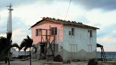 Old house by lighthouse, La Boca, Cuba
