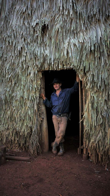 Farmer stands in the doorway of the tobacco drying barn Viñales Cuba