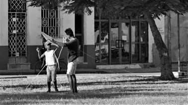 Boy learning to fly kite, Camagüey, Cuba