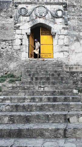 Bright yellow door of Monasteria De San Francisco. First Monostery in the Americas. Santo Domingo. Dominican Republic