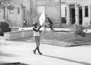 Boy flying kite, Camagüey, Cuba