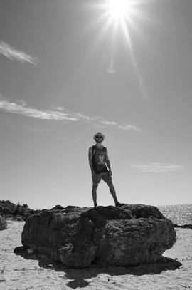 Standing on a rock on the beach, Trinidad, Cuba