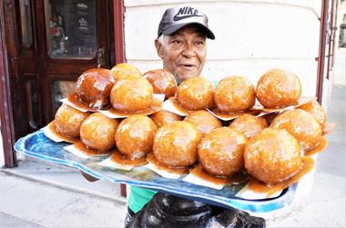 Cuban man caramel coconut balls, Havana, Cuba