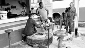 Mechanics fixing the wheel of our bus, Trinidad, Cuba