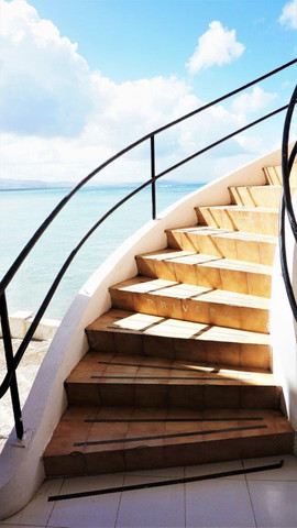 Winding staircase by the Caribbean sea. Bahia Blanca Hotel. Rio San Juan Dominican Republic.