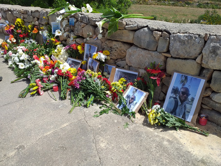 Laying flowers for Lassana Cisse