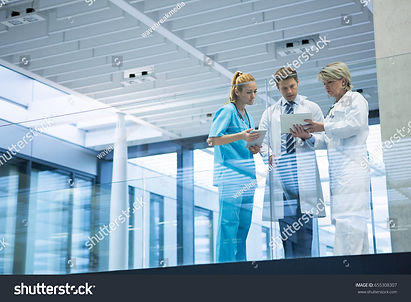 stock-photo-medical-team-discussing-over