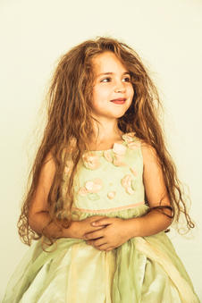 Portrait of little girl in green dress