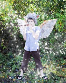 lost boy with magic flute in woods photograph