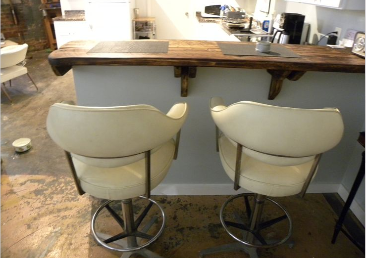Item: Vinyl captains chairs