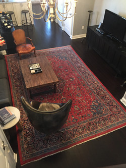 Item: Rug and leather chair
