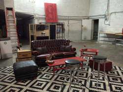 Item: Couch, stools, table, decor