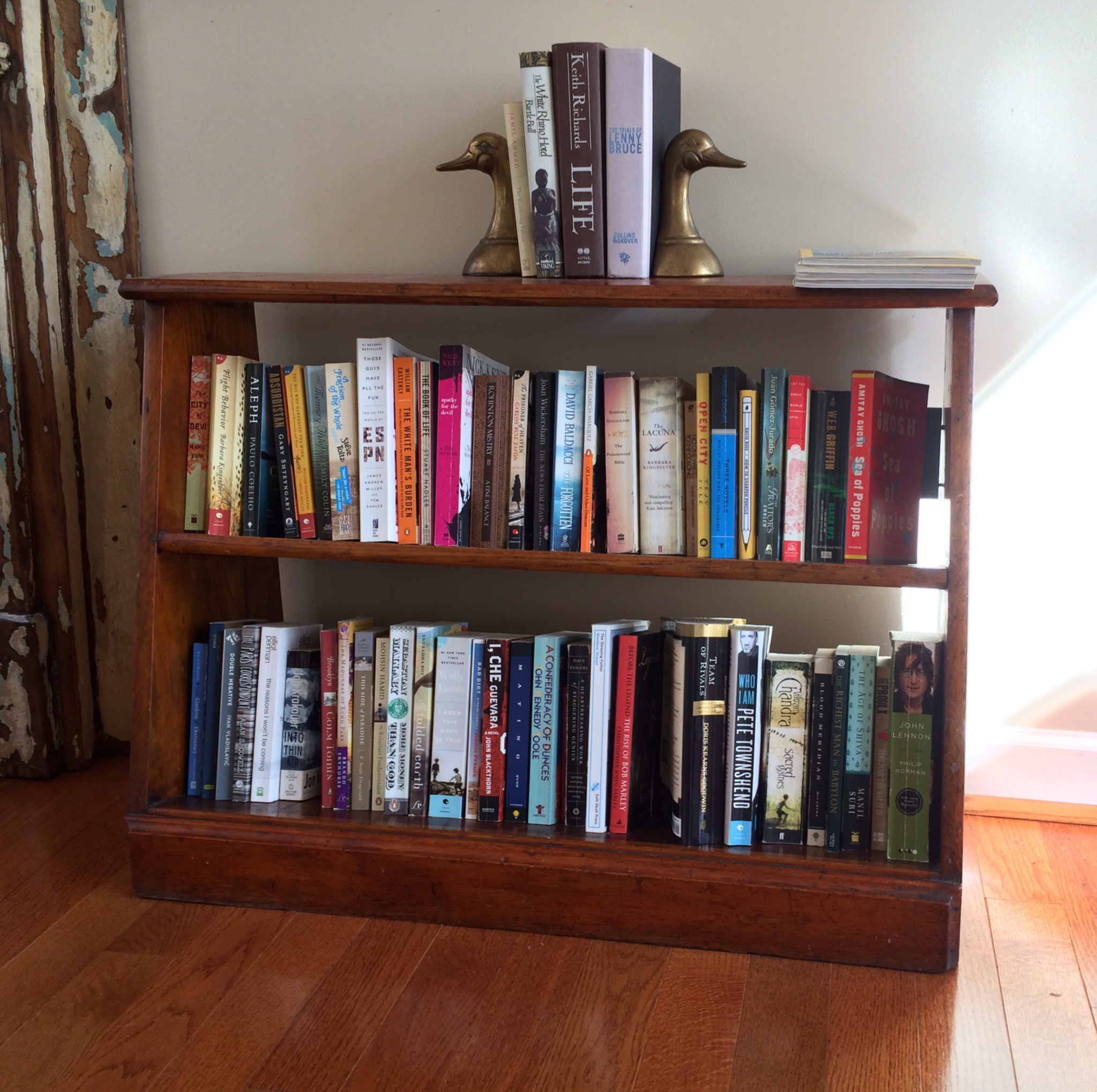 Item: Bookshelf, brass bookends