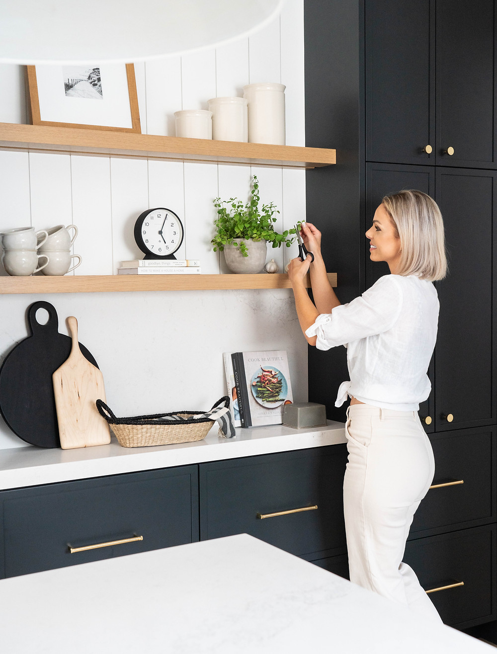 """Though considered shallower than the conventional depth for a pantry, the 12"""" cupboards, drawers, and shelves present functional storage and ample opportunities for keeping small appliances out of sight."""